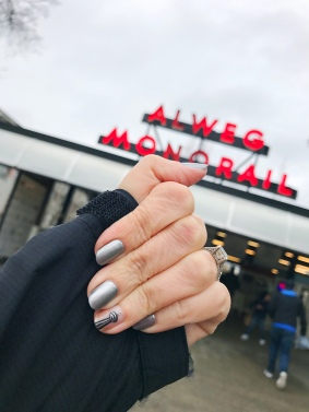 mani monday space needle monorail